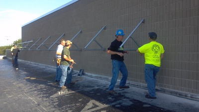 IBEW Local 158 volunteers for PV installation at Boys and Girls Club Green Bay 2013